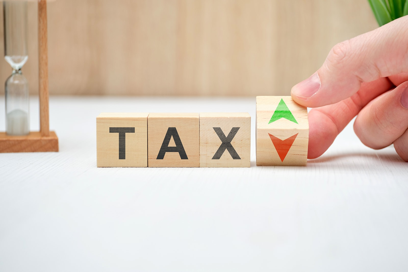 bigstock-Tax-Concept-With-Up-And-Down-A-365216155-min