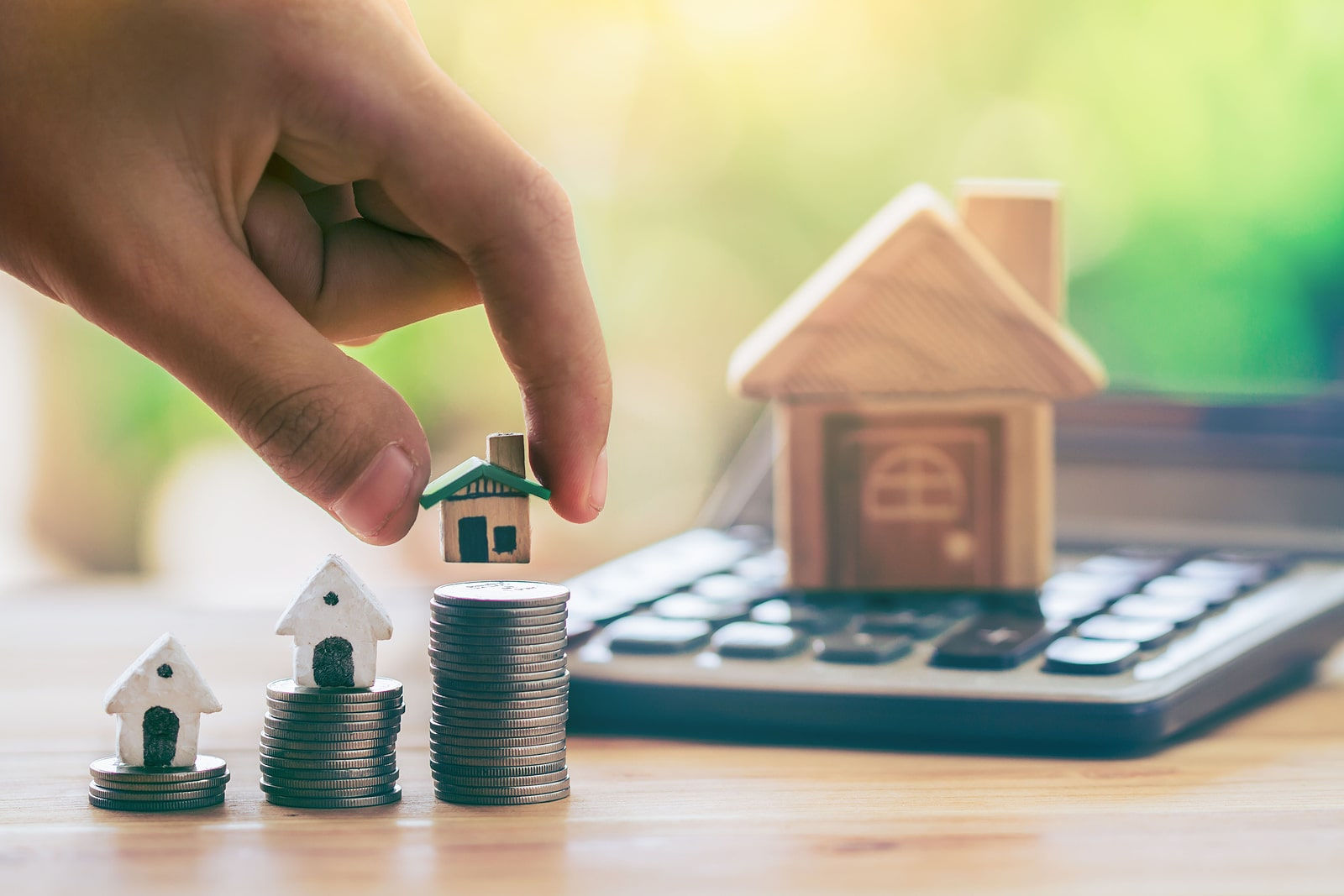 bigstock-House-On-Coins-And-House-Put-O-357127139-min